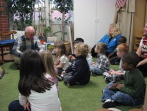 Les reading to kids